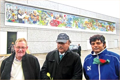 Rajshahi City Corporation Mayor AHM Khairuzzaman Liton, Kristiansand city Mayor Oddvar Munks Gaard and artist Ismail Hossain stand in front of a mural presented as a gift to the Norwegian city by the corporation.